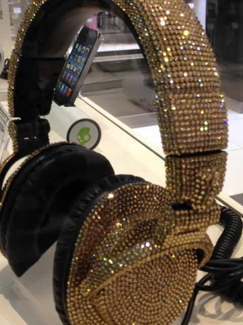 fancy, sparkly headphones in airport store display case