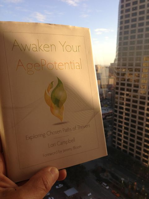 jeff noel holding a copy of Awaken Your AgePotential at Hyatt Regency New Orleans