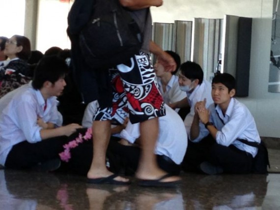 Uniformed Japanese school boys and an adult in aloha pants
