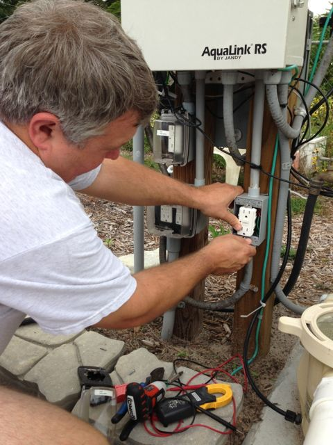 Florida electrician working on pool equipment