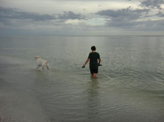 Boy and his Dog at the beach