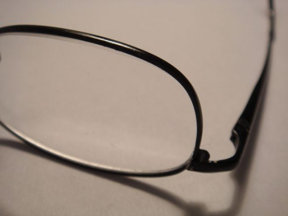 closeup photo of reading glasses