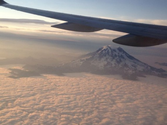 Mt Rainier rising above the clouds just after sunrise
