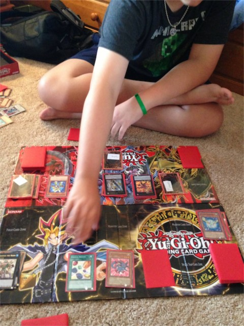 Father and Son playing Yugioh card game