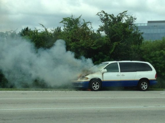 Passenger van on fire along Florida roadway