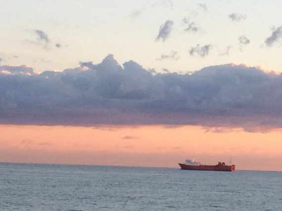Freight ship off Palm Beach, Florida coast at sunrise