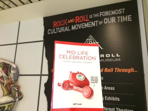 Mid Life Celebration book and Rock and Roll Hall of Fame marque