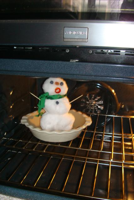 Small snowman placed in oven