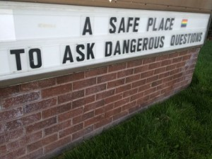 Church sign welcoming tough questions