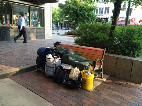 Homeless Iowa City person sleeping on city bench