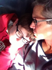 father and Son snuggling on cross country flight