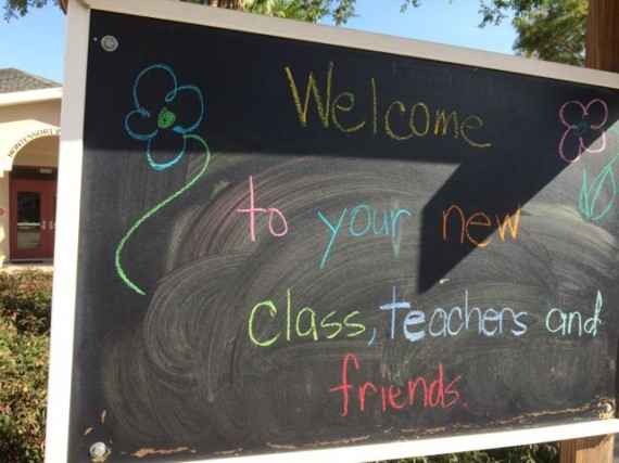 Colorful welcome sign on parking lot chalk board