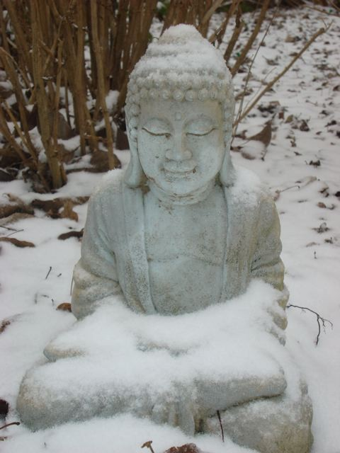 Buddha statue covered in snow
