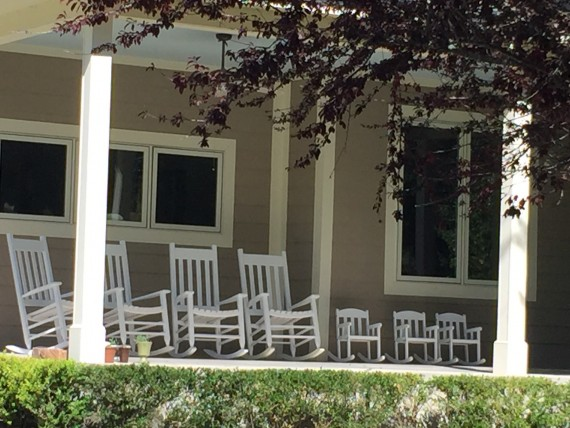 Adult and child rocking chairs on front porch